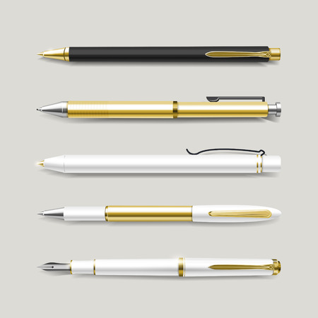 pen: graceful gold pens set isolated on beige background