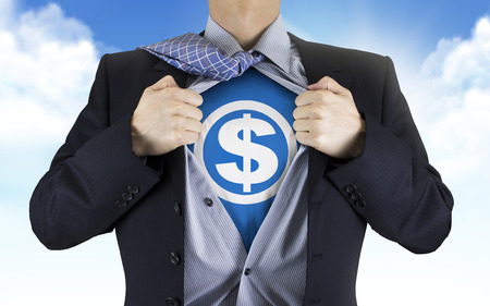 underneath: businessman showing money icon underneath his shirt over blue sky