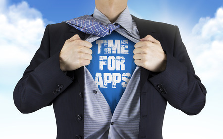 underneath: businessman showing Time for apps words underneath his shirt over blue sky
