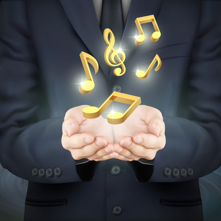 close-up look at businessman holding golden music notes