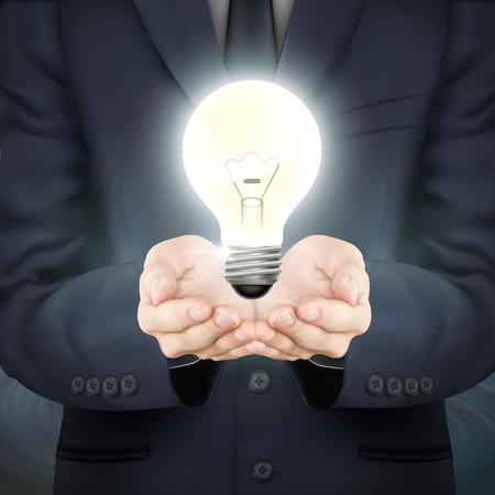 lighting bulb: close-up look at businessman holding lighting bulb