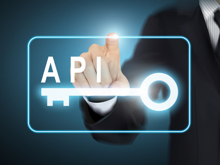 api: male hand pressing API key button over blue abstract background