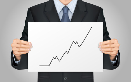 growing business: close-up look at businessman holding growing business graph