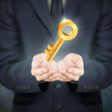 golden key: close-up look at businessman holding a golden key