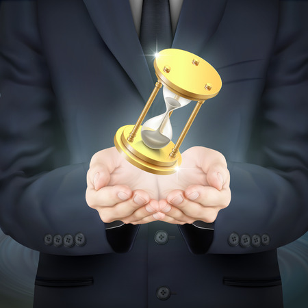 gold rush: close-up look at businessman holding a hourglass