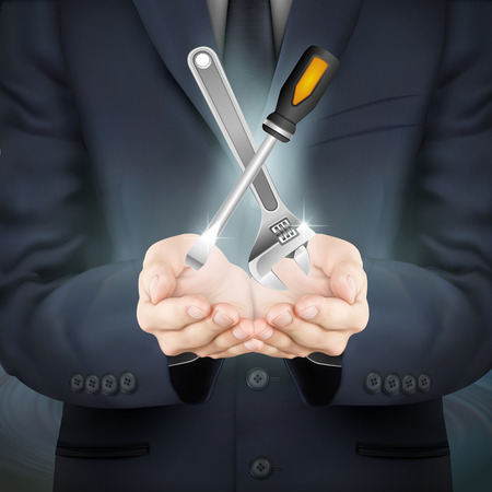 instrumentation: close-up look at businessman holding tools set