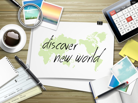 top of the world: top view of travel items on wooden table with discover new world written on paper
