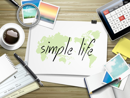 simple life: top view of travel items on wooden table with simple life written on paper