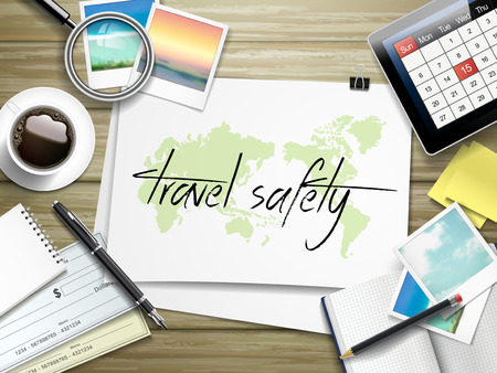touristic: top view of travel items on wooden table with travel safety written on paper