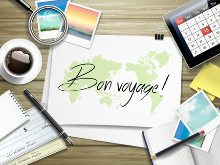 voyage: top view of travel items on wooden table with bon voyage written on paper Illustration