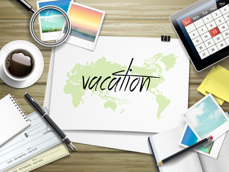 written: top view of travel items on wooden table with vacation word written on paper