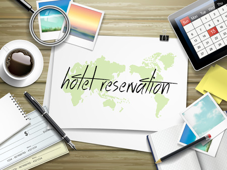 reservation: top view of travel items on wooden table with hotel reservation written on paper