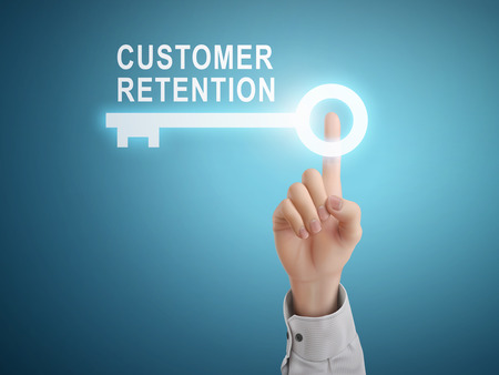 retention: male hand pressing customer retention key button over blue abstract background