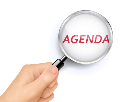 meeting agenda: agenda showing through magnifying glass held by hand