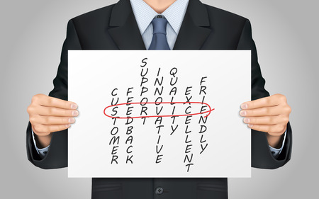 crossword: close-up look at businessman holding service crossword poster