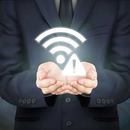 malfunction: close-up look at businessman holding wifi connection problem icon