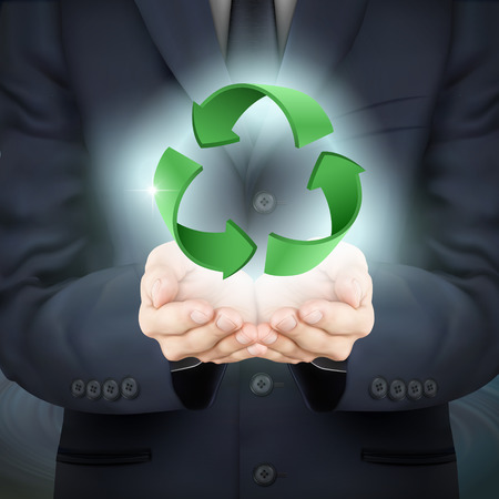 environmental suit: close-up look at businessman holding recycle sign
