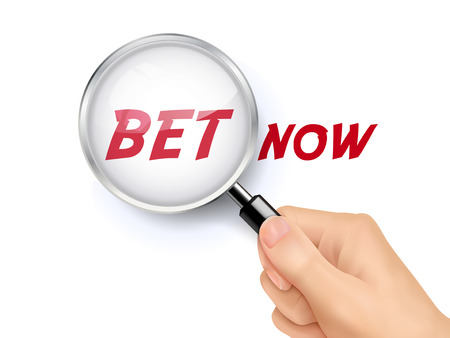 pledge: bet now showing through magnifying glass held by hand