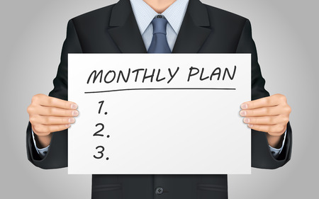 close-up look at businessman holding monthly plan words poster