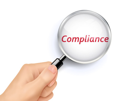 compliance showing through magnifying glass held by hand