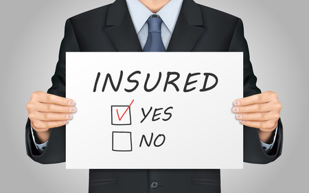closeup: close-up look at businessman holding yes insured poster