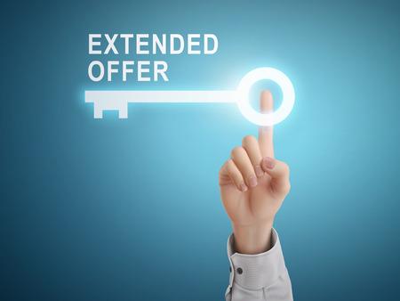 estendido: male hand pressing extended offer key button over blue abstract background Ilustração