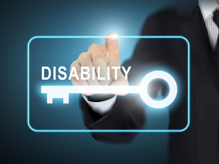benefits: male hand pressing disability key button over blue abstract background