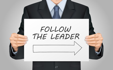 lighting button: close-up look at businessman holding follow the leader poster