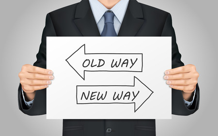 challenges: close-up look at businessman holding old way or new way poster