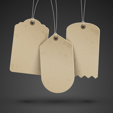 sale sign: blank brown price tags hanging on the black wall Illustration