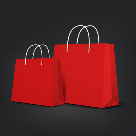 red paper: orange shopping bags set isolated on black background