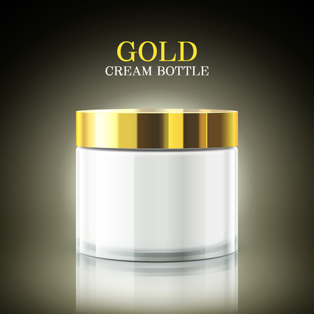 woman face cream: gold cream bottle package isolated on black background