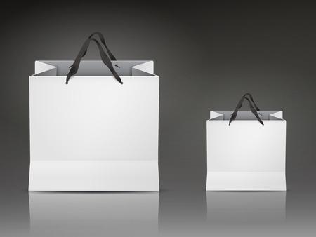 witte boodschappentassen set geïsoleerd op een zwarte achtergrond