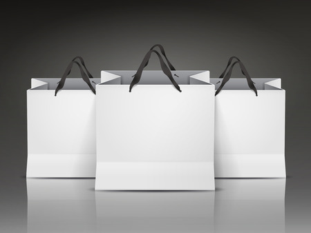 paper product: white shopping bags set isolated on black background