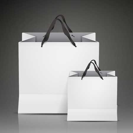 merchandise: white shopping bags set isolated on black background