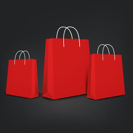 黒の背景に分離されたオレンジ色の買い物袋セット