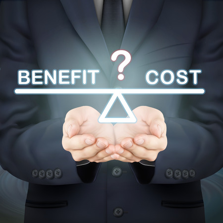 benefits: close-up look at businessman holding benefit and cost seesaw