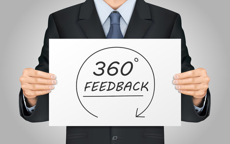 close-up look at businessman holding 360 feedback content poster Stock Illustratie