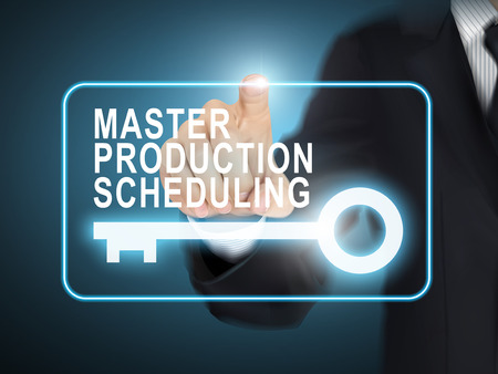 male hand: male hand pressing master production scheduling key button over blue abstract background