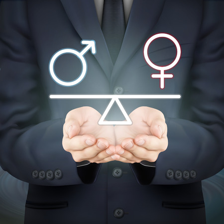 male female: close-up look at businessman holding male and female symbol seesaw