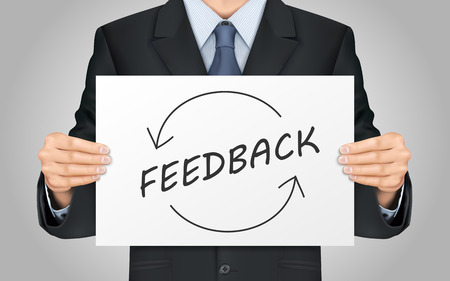 respond: close-up look at businessman holding feedback poster
