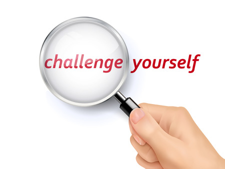 hand held: challenge yourself showing through magnifying glass held by hand