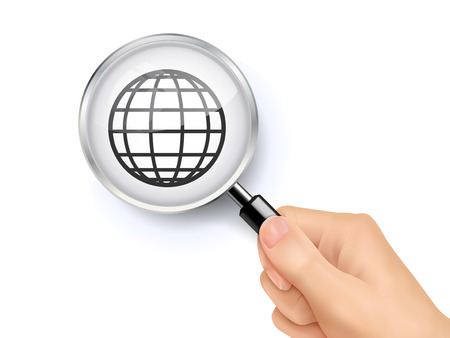 internet symbol: internet symbol showing through magnifying glass held by hand