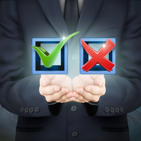 green check mark: close-up look at businessman holding red and green check mark icons