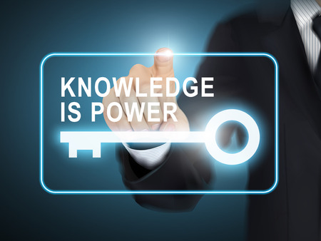 powers: male hand pressing knowledge is power key button over blue abstract background
