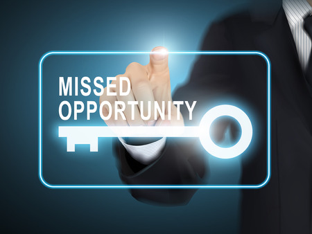 opportunity sign: male hand pressing missed opportunity key button over blue abstract background