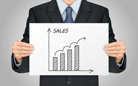 sales growth: close-up look at businessman holding sales growth graph