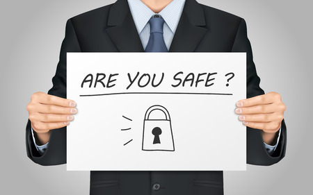 close-up look at businessman holding are you safe poster
