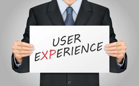 interactions: close-up look at businessman holding user experience poster