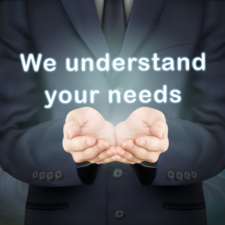 understand: close-up look at businessman holding we understand your needs words